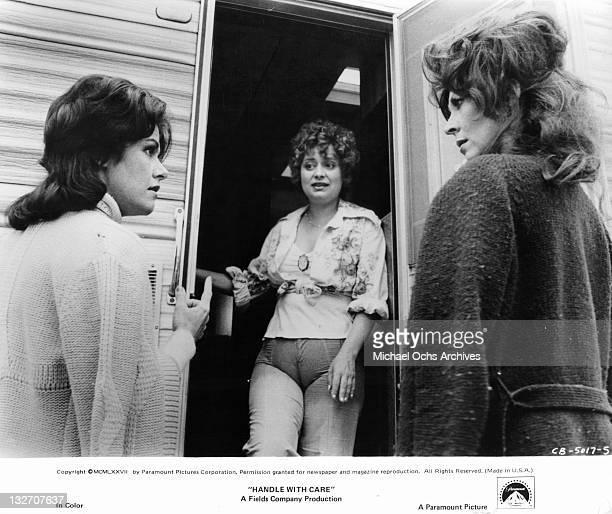 Marcia Rodd and Ann Wedgeworth share a look of surprise when Alix Elias answers the doorbell in a scene from the film 'Handle With Care' 1977