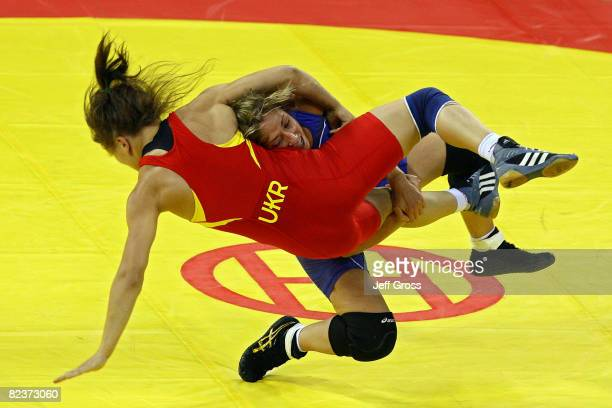 Marcie Van Dusen of the United States takes down Nataliya Synyshyn of Ukraine during the women's freestyle 55kg wrestling match at the China...