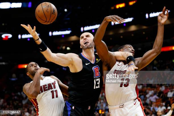 Marcin Gortat of the LA Clippers battles for a rebound with Bam Adebayo and Dion Waiters of the Miami Heat during the first half at American Airlines...
