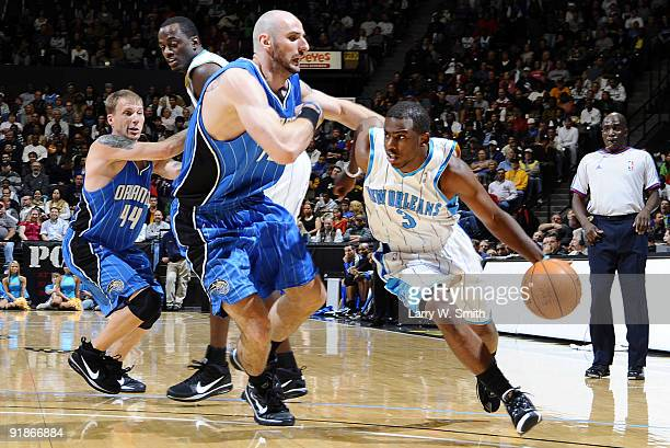 Marcin Gortat of the Orlando Magic guards against Chris Paul as he drives to the basket of the New Orleans Hornets at Charles Koch Arena at Wichita...
