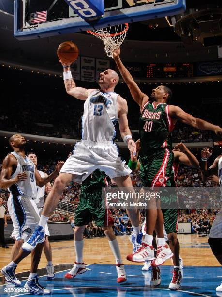 Marcin Gortat of the Orlando Magic pulls down a rebound against Kurt Thomas of the Milwaukee Bucks during the game on December 30 2009 at Amway Arena...