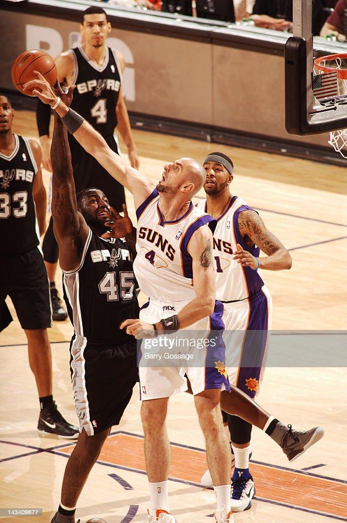 Marcin Gortat #4 of the Phoenix Suns blocks the shot of DeJuan Blair #45 of the San Antonio Spurs on April 25, 2012 at U.S. Airways Center in Phoenix, Arizona.