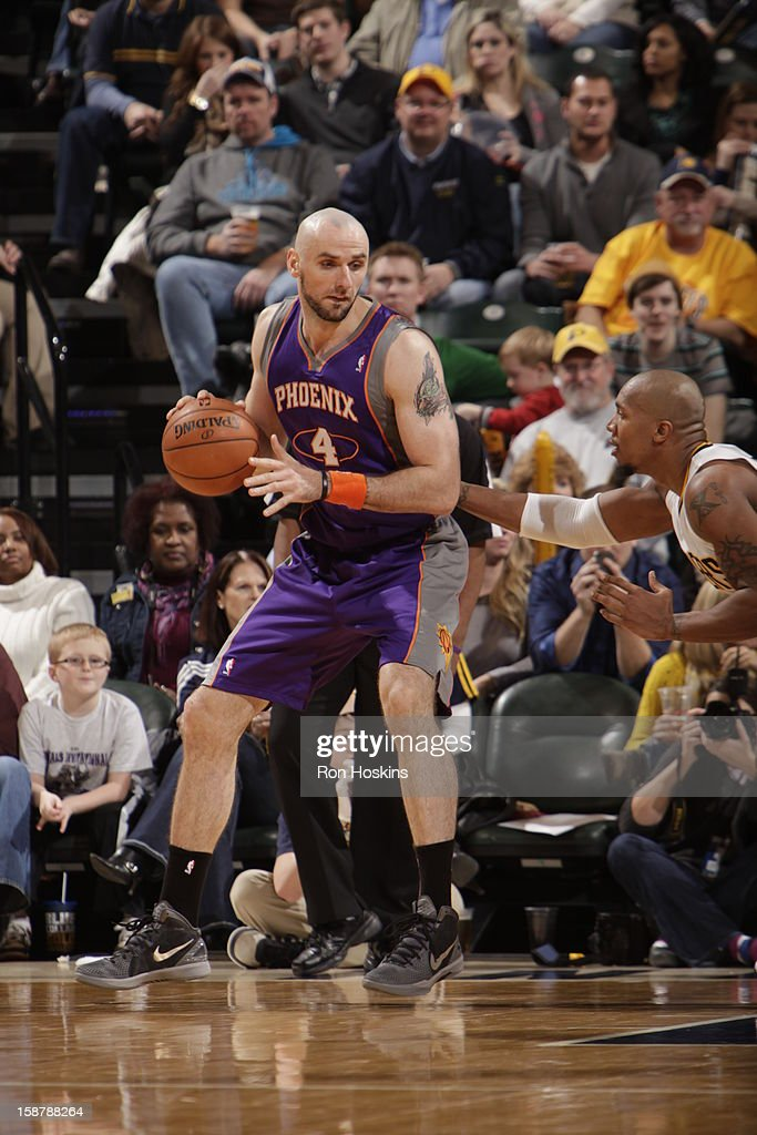 Marcin Gortat #4 of the Phoenix Suns controls the ball against David West #21 of the Indiana Pacers on December 28, 2012 at Bankers Life Fieldhouse in Indianapolis, Indiana.