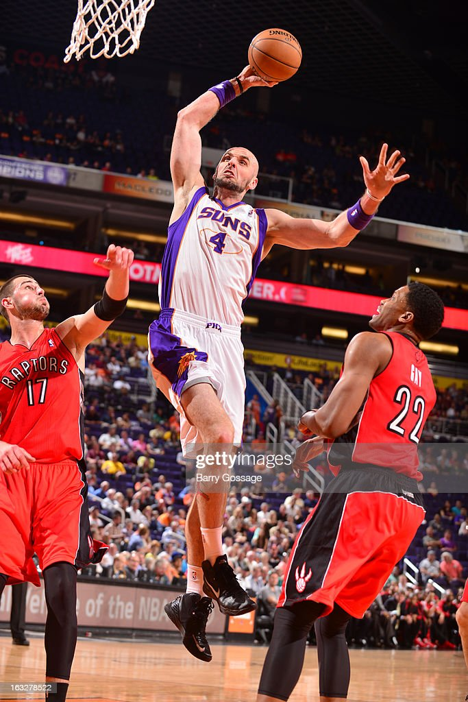 Marcin Gortat #4 of the Phoenix Suns drives for a shot against the Toronto Raptors on March 6, 2013 at U.S. Airways Center in Phoenix, Arizona.