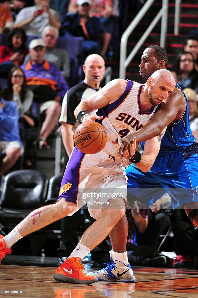 Marcin Gortat #4 of the Phoenix Suns drives to the basket against the Dallas Mavericks on February 1, 2013 at U.S. Airways Center in Phoenix, Arizona.