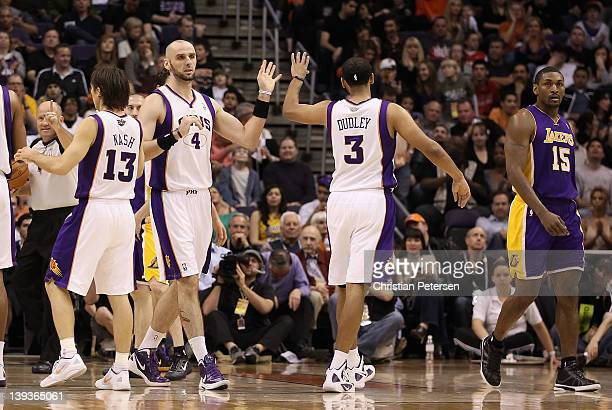 Marcin Gortat of the Phoenix Suns highfives Jared Dudley after scoring against the Los Angeles Lakers during the NBA game at US Airways Center on...