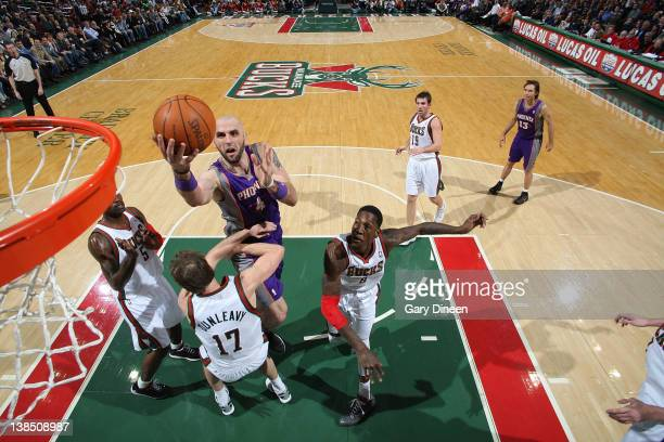Marcin Gortat of the Phoenix Suns shoots a layup against Stephen Jackson Mike Dunleavy and Larry Sanders of the Milwaukee Bucks during the game on...