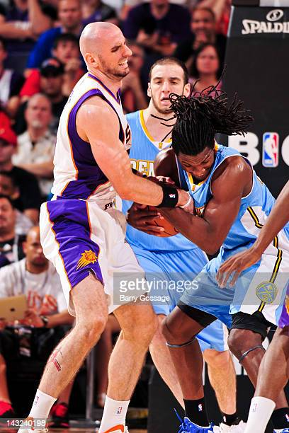 Marcin Gortat of the Phoenix Suns tries to strip the ball from Kenneth Faried of the Denver Nuggets on April 21 2012 at US Airways Center in Phoenix...