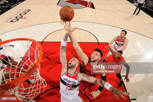 Marcin Gortat of the Washington Wizards and Jusuf Nurkic of the Portland Trail Blazers go for the rebound during the game on December 5 2017 at the...