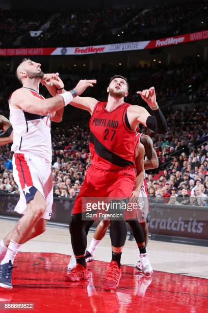 Marcin Gortat of the Washington Wizards and Jusuf Nurkic of the Portland Trail Blazers await the ball during the game on December 5 2017 at the Moda...