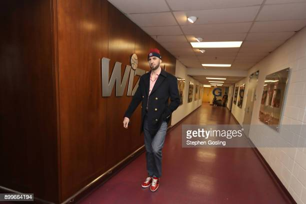Marcin Gortat of the Washington Wizards arrives before the game against the Houston Rockets on December 29 2017 at Capital One Arena in Washington DC...