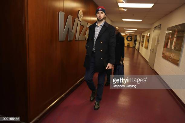 Marcin Gortat of the Washington Wizards arrives before the game against the Chicago Bulls on December 31 2017 at Capital One Arena in Washington DC...