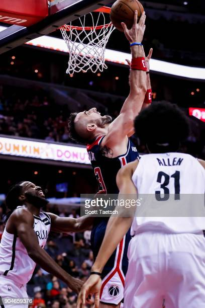 Marcin Gortat of the Washington Wizards attempts a lay up during the game between the Washington Wizards and the Brooklyn Nets at Capital One Arena...