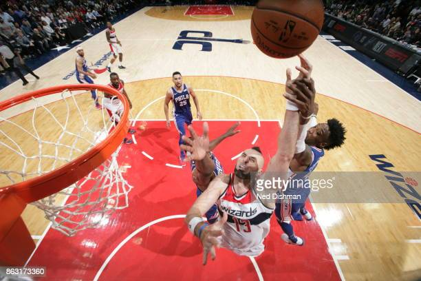 Marcin Gortat of the Washington Wizards attempts to drives to the basket against the Philadelphia 76ers on October 18 2017 at Capital One Arena in...