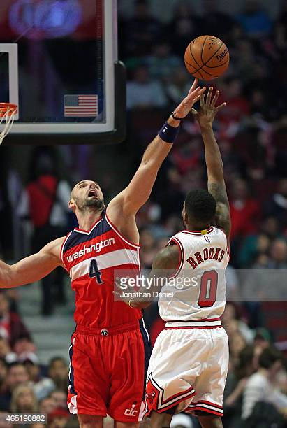 Marcin Gortat of the Washington Wizards blocks a shot by Aaron Brooks of the Chicago Bulls at the United Center on March 3 2015 in Chicago Illinois...
