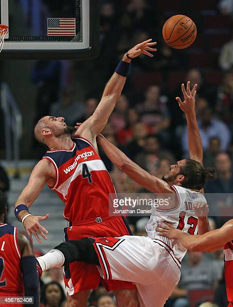 Marcin Gortat of the Washington Wizards blocks a shot by Joakim Noah of the Chicago Bulls during a preseason game at the United Center on October 6...