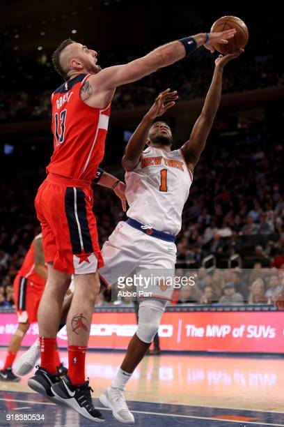 Marcin Gortat of the Washington Wizards defends against Emmanuel Mudiay of the New York Knicks in the fourth quarter during their game at Madison...