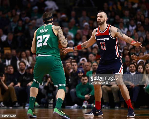 Marcin Gortat of the Washington Wizards defends Daniel Theis of the Boston Celtics during the game at TD Garden on December 25 2017 in Boston...