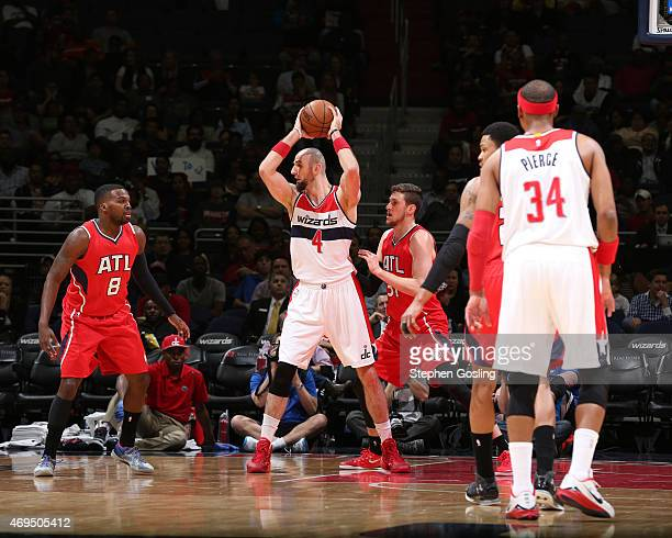 Marcin Gortat of the Washington Wizards defends the ball against the Atlanta Hawks during the game on April 12 2015 at Verizon Center in Washington...