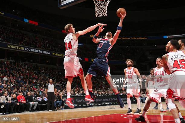 Marcin Gortat of the Washington Wizards drives to the basket against the Chicago Bulls on December 31 2017 at Capital One Arena in Washington DC NOTE...