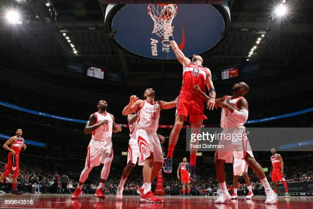Marcin Gortat of the Washington Wizards dunks against the Houston Rockets on December 29 2017 at Capital One Arena in Washington DC NOTE TO USER User...