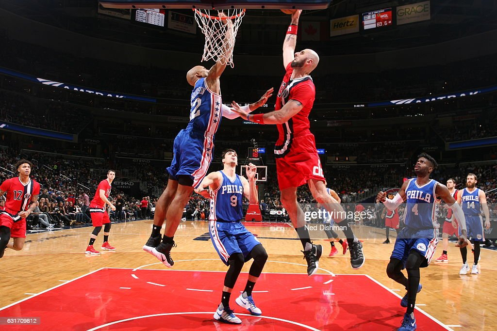 Marcin Gortat #13 of the Washington Wizards goes to the basket against the Philadelphia 76ers on January 14, 2017 at Verizon Center in Washington, DC.