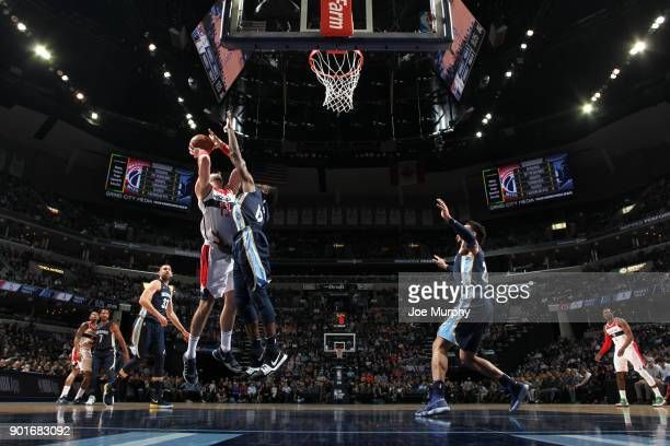 Marcin Gortat of the Washington Wizards goes to the basket against the Memphis Grizzlies on January 5 2018 at FedExForum in Memphis Tennessee NOTE TO...