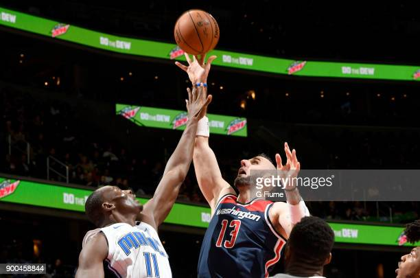 Marcin Gortat of the Washington Wizards grabs a rebound against the Orlando Magic at Capital One Arena on December 23 2017 in Washington DC NOTE TO...