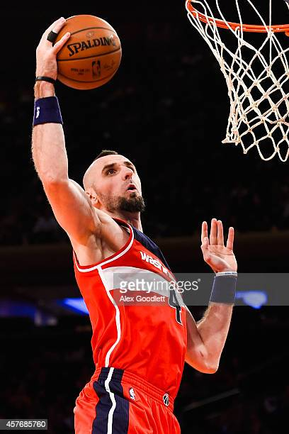 Marcin Gortat of the Washington Wizards grabs a rebound in a preseason game against the New York Knicks at Madison Square Garden on October 22 2014...