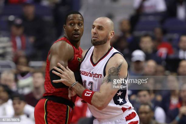 Marcin Gortat of the Washington Wizards guards Dwight Howard of the Atlanta Hawks in the first half in Game Five of the Eastern Conference...