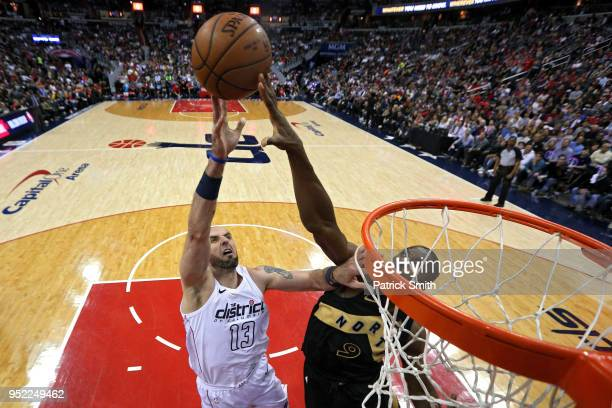 Marcin Gortat of the Washington Wizards has his shot blocked by Serge Ibaka of the Toronto Raptors in the first half during Game Six of Round One of...