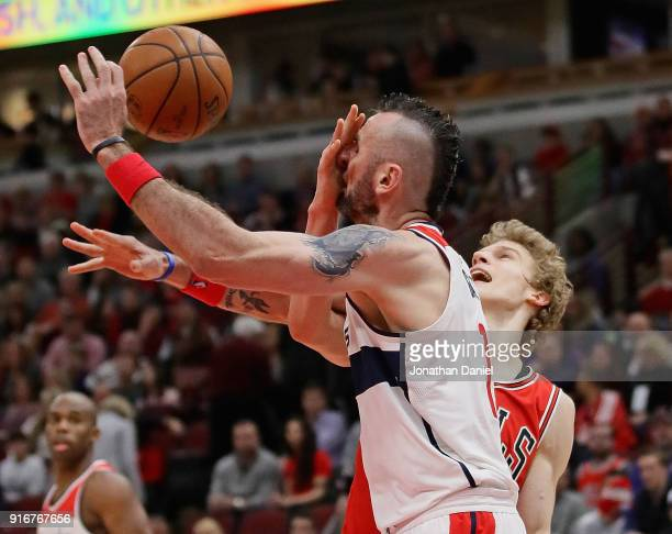 Marcin Gortat of the Washington Wizards is fouled by Lauri Markkanen of the Chicago Bulls at the United Center on February 10 2018 in Chicago...