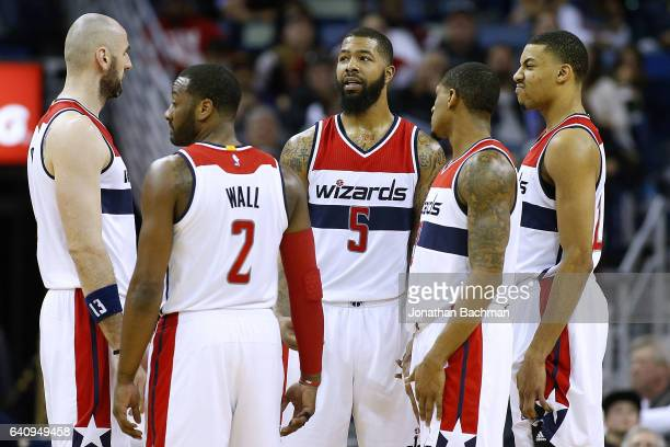Marcin Gortat of the Washington Wizards John Wall Markieff Morris Otto Porter Jr #22 and Bradley Beal talk during the second half of a game against...