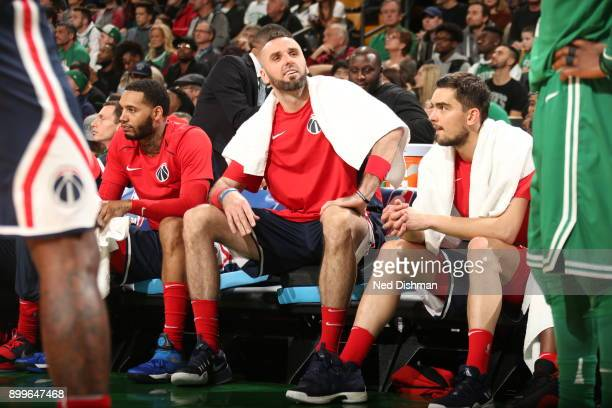 Marcin Gortat of the Washington Wizards looks on from the bench during the game against the Boston Celtics on December 25 2017 at the TD Garden in...
