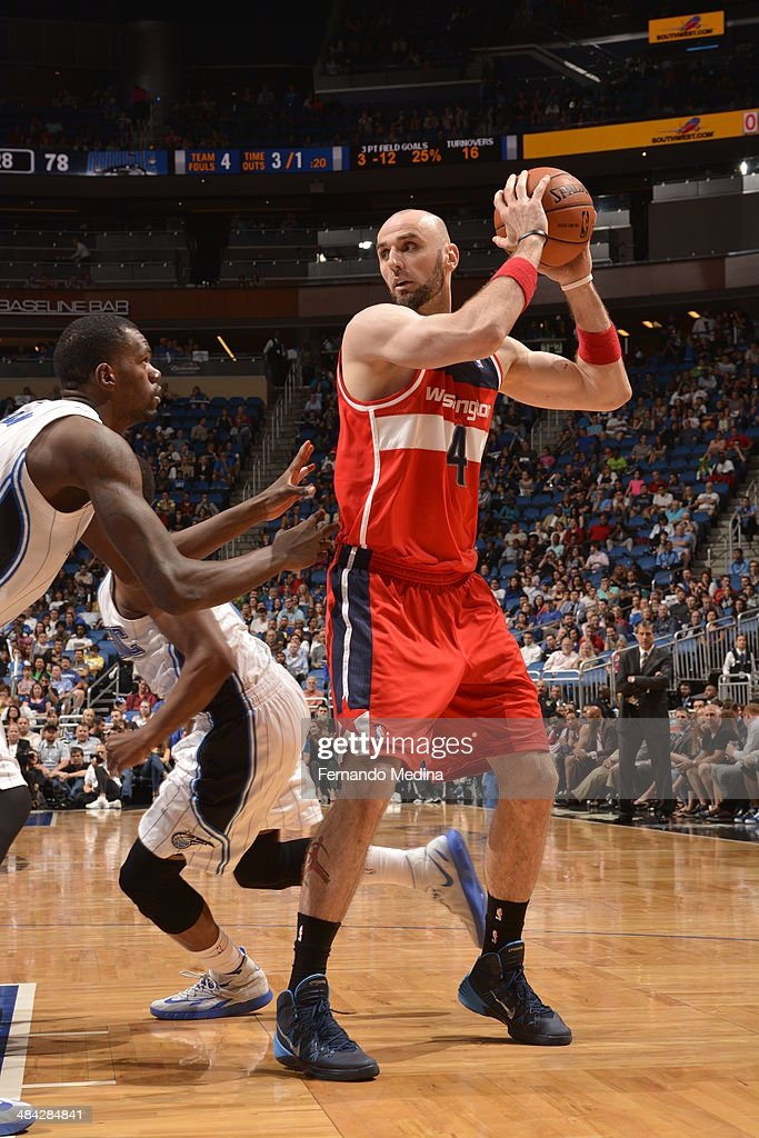Marcin Gortat #4 of the Washington Wizards looks to pass the ball against the Orlando Magic during the game on April 11, 2014 at Amway Center in Orlando, Florida.