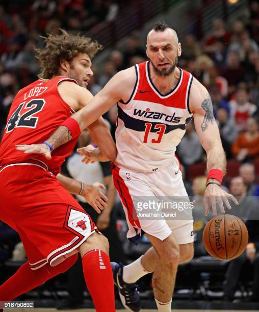 Marcin Gortat of the Washington Wizards moves around Robin Lopez of the Chicago Bulls at the United Center on February 10 2018 in Chicago Illinois...