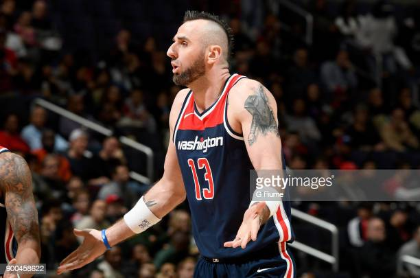 Marcin Gortat of the Washington Wizards reacts to a call during the game against the Orlando Magic at Capital One Arena on December 23 2017 in...