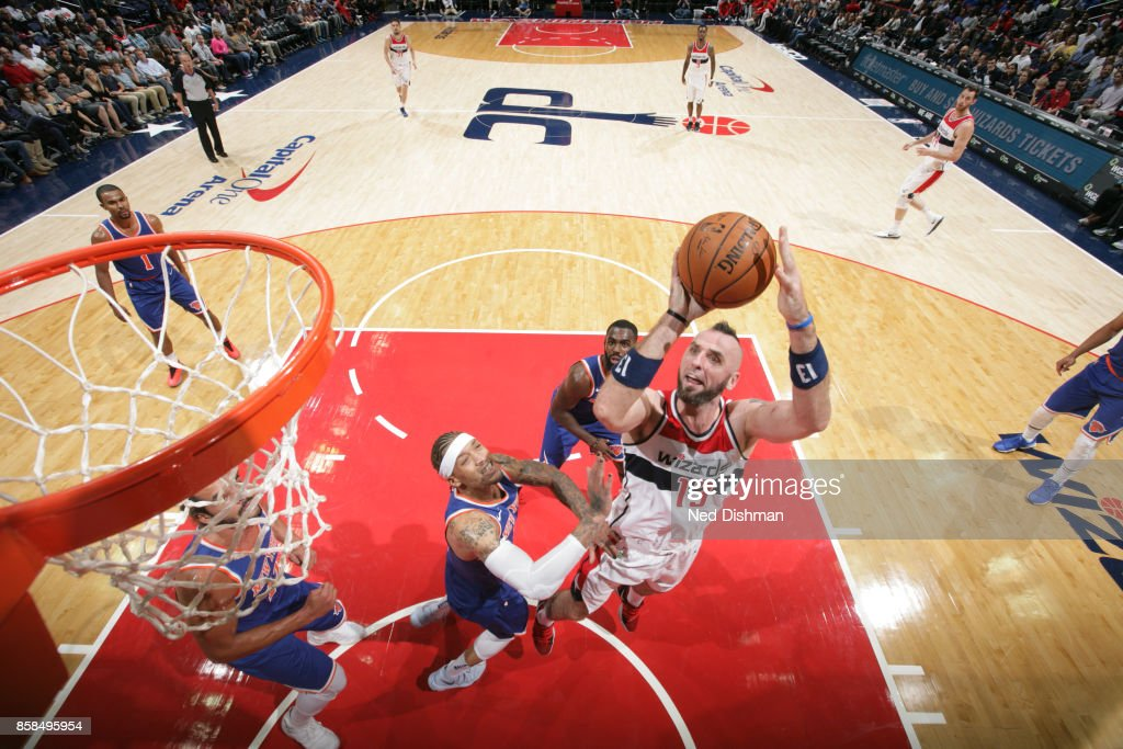 Marcin Gortat #13 of the Washington Wizards shoots the ball against the New York Knicks during the preseason game on October 6, 2017 at Capital One Arena in Washington, DC.