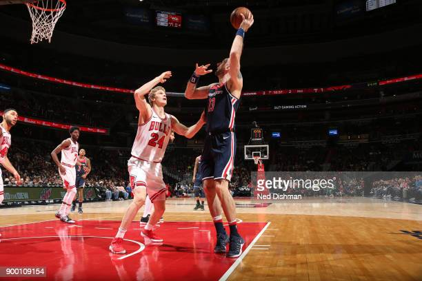Marcin Gortat of the Washington Wizards shoots the ball against the Chicago Bulls on December 31 2017 at Capital One Arena in Washington DC NOTE TO...