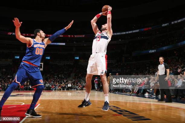 Marcin Gortat of the Washington Wizards shoots the ball against the New York Knicks on January 3 2018 at Capital One Arena in Washington DC NOTE TO...
