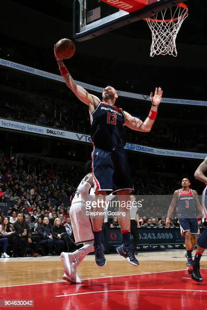 Marcin Gortat of the Washington Wizards shoots the ball against the Brooklyn Nets on January 13 2018 at Capital One Arena in Washington DC NOTE TO...