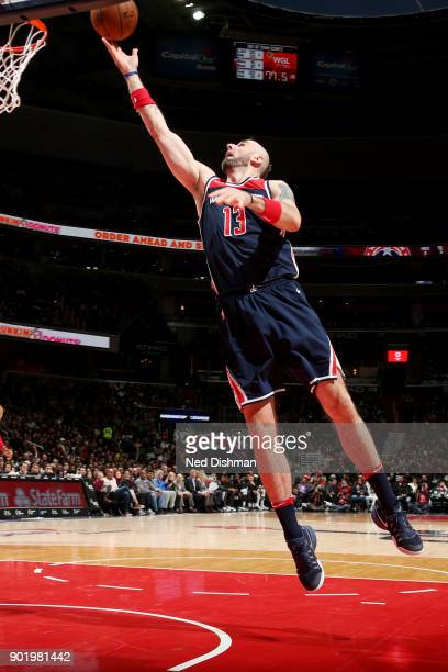 Marcin Gortat of the Washington Wizards shoots the ball during the game against the Milwaukee Bucks on January 6 2018 at Capital One Arena in...