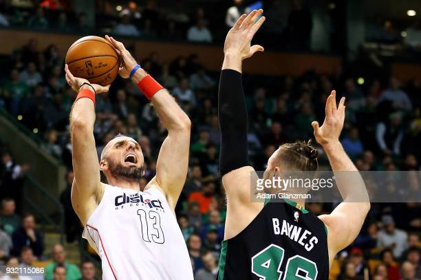 Marcin Gortat of the Washington Wizards shoots the ball over Aron Baynes of the Boston Celtics in the first quarter of a game at TD Garden on March...