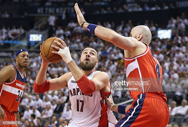 Marcin Gortat of the Washington Wizards stops Jonas Valanciunas of the Toronto Raptors in Game Two of the Eastern Conference Quarterfinals during the...
