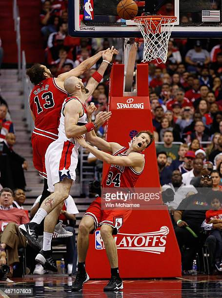 Marcin Gortat of the Washington Wizards takes the ball to the basket against Joakim Noah and teammate Mike Dunleavy of the Chicago Bulls in Game Four...