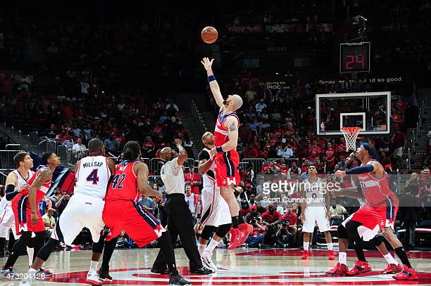 Marcin Gortat of the Washington Wizards tips off against Al Horford of the Atlanta Hawks in Game Five of the Eastern Conference Semifinals during the...
