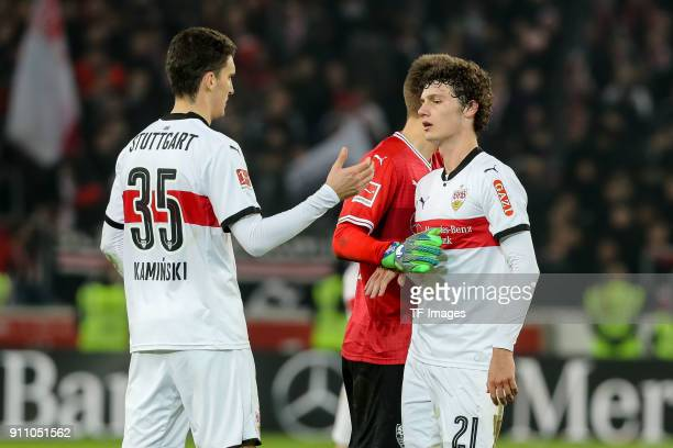 Marcin Kaminski of Stuttgart RonRobert Zieler of Stuttgart and Benjamin Pavard of Stuttgart looks dejected after the Bundesliga match between VfB...