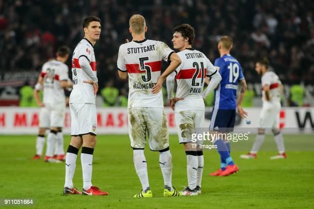Marcin Kaminski of Stuttgart Timo Baumgartl of Stuttgart and Benjamin Pavard of Stuttgart looks dejected after the Bundesliga match between VfB...