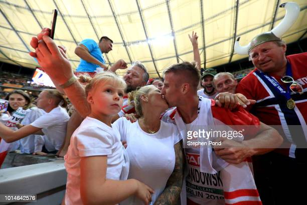 Marcin Lewandowski of Poland celebrates with his family after winning Silver in the Men's 1500m Final during day four of the 24th European Athletics...