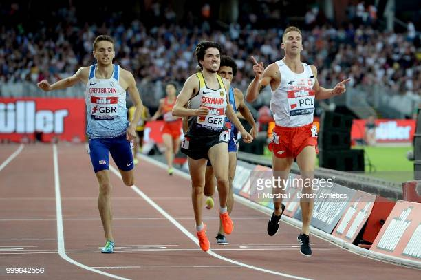 Marcin Lewandowski of Poland crosses the line to win the Men's 1500m during day two of the Athletics World Cup London at the London Stadium on July...